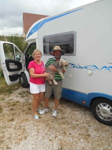 The Croziers arrive to collect their campervan with Buster the dog
