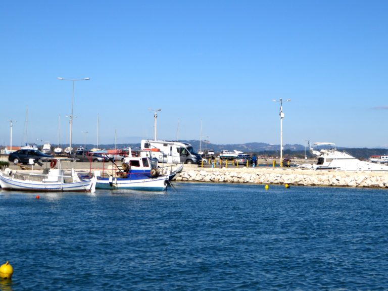 Sharni and Todd's Hymer motorhome nestling between the fishing boats in Greece