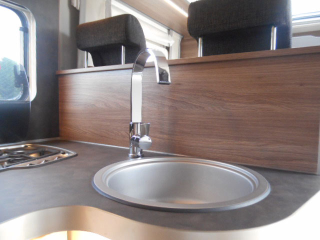The alcove kitchen is neat and practical with a good sized sink, three ring hob and full height fridge freezer