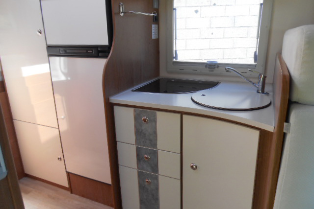 The alcove kitchen and large fridge freezer give this motorhome  a real home from home feel