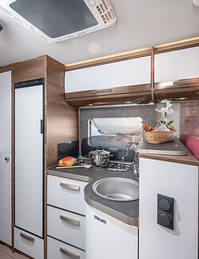 The kitchen on the Knaus Live I has great storage, plenty of worktop and a very big fridge freezer
