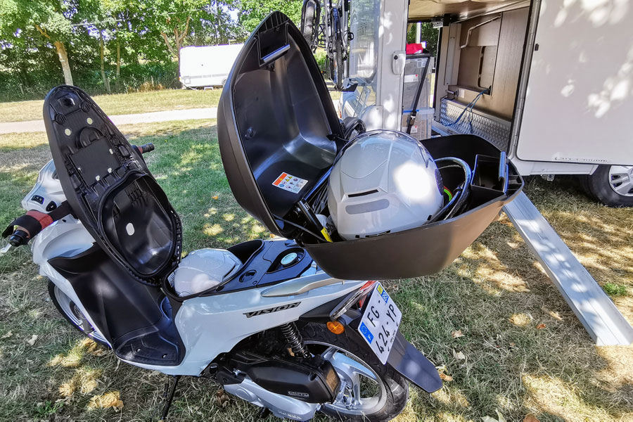Helmet storage on scooter. Rear view mirrors and top box were removed before loading into motorhome to allow bed level to be as low as possible