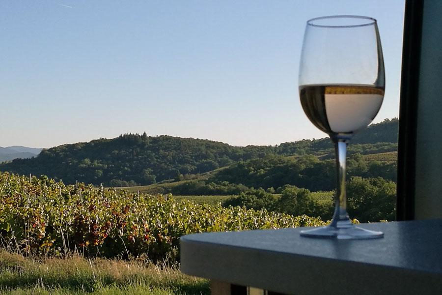 Enjoying an aperitif overlooking the vineyards of Beaujolais as the sun sets