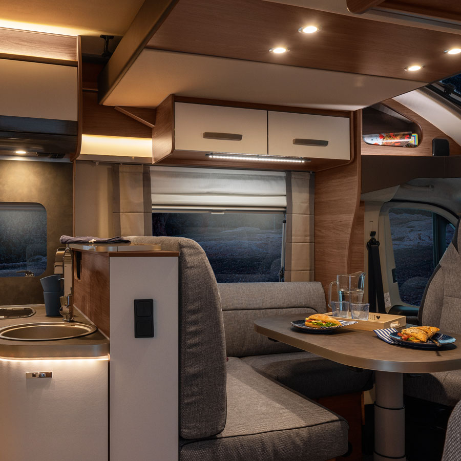 Modern motorhomes are designed for use in winter.  The L shaped lounge in the 2020 Knaus Live Wave is truly sumptuous so ideal for enjoying comfort food and a movie on a winters evening