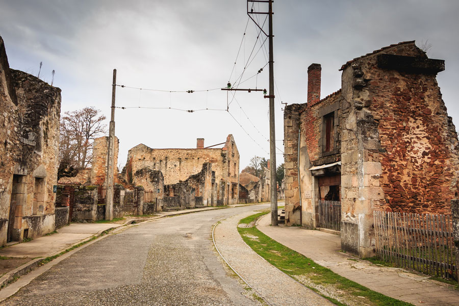 A sign at the entrance to the old village asks you remain respectfully silent as you walk through the streets of Oradour sur Glane