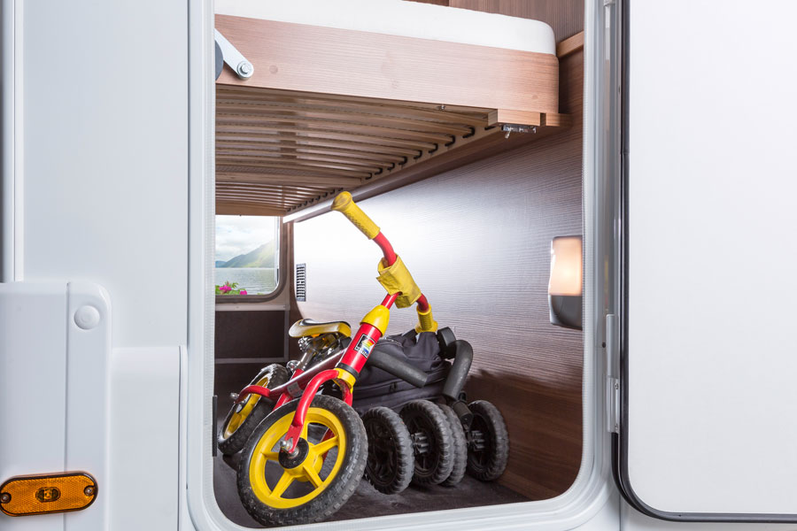 From outdoor tables and chairs to kids bikes and buggies, the garage locker will swallow anything you want to take with you on your family trip.  There is even a bike rack too.