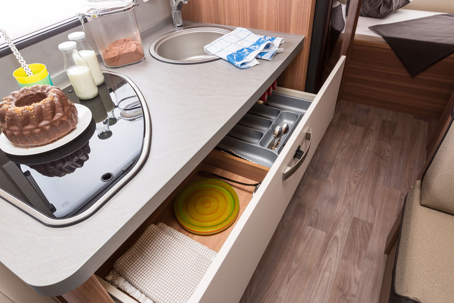 Huge drawers with soft closers provide space to stow all you need for family catering